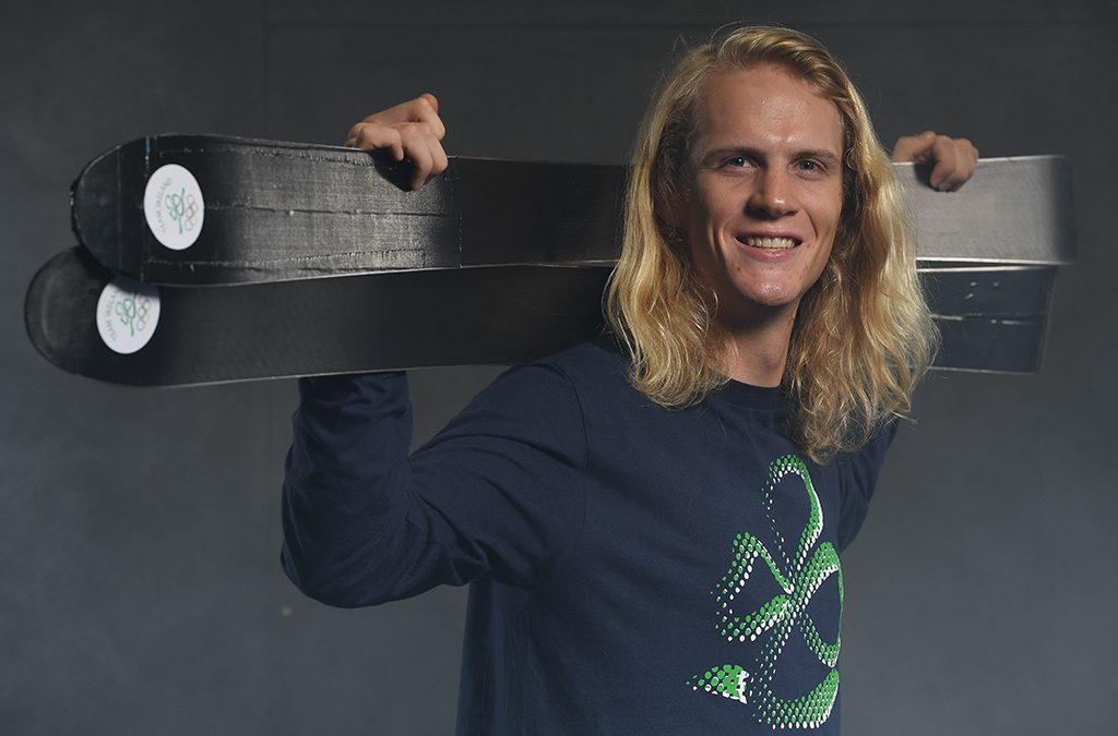 Brendan 'Bubba' Newby skis the halfpipe in mismatched skis